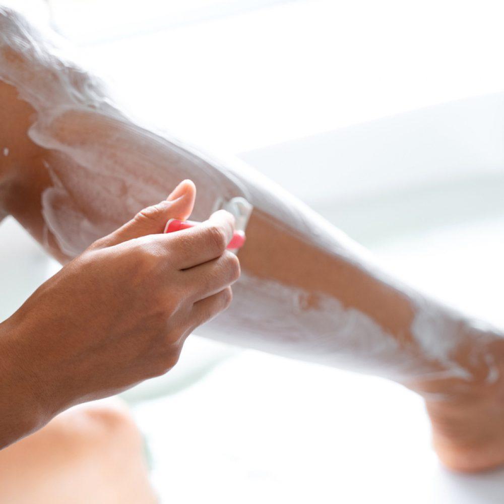 Woman shaving legs ingrown hair